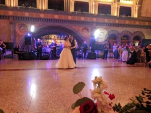 A wedding couple dancing at Union Station. They took dance lessons at Prestige Ballroom Dancing in St. Louis, MO.